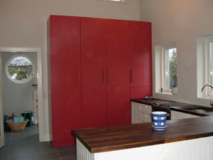 Red Painted with Cream and Walnutt mixed Fitted Kitchen